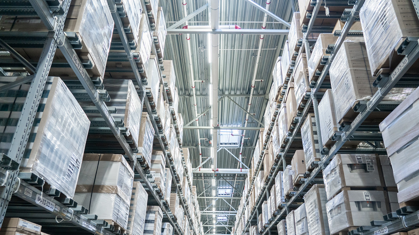 Rows of shelves in modern warehouse